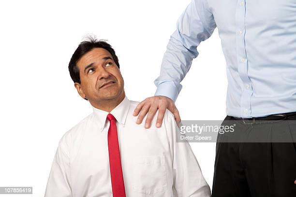 Latino Businessman Being Pushed Down
