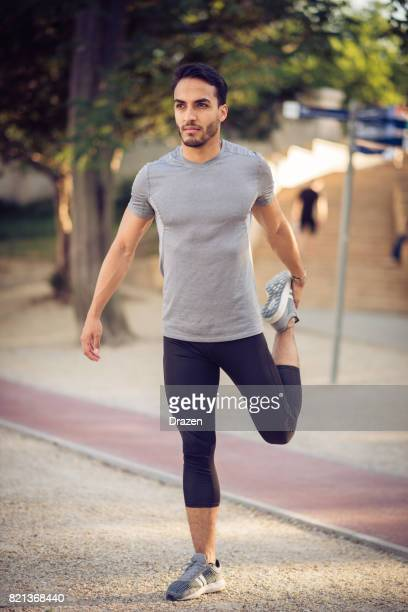 Latino man in sport clothing getting ready for the training