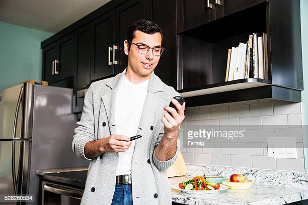 Latino man monitoring his diabetes.