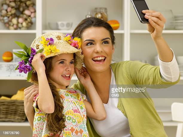 Latino mother and child with Easter bonnet