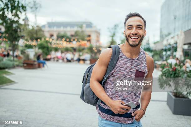 latino traveler with backpack discovering europe - ventenne foto e immagini stock