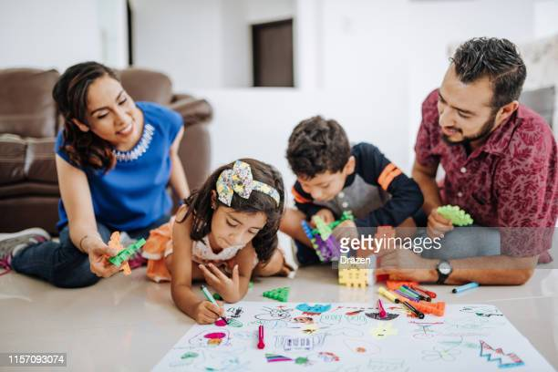 latinohispanic family at home, enjoying weekend with kids. - family at home stock pictures, royalty-free photos & images