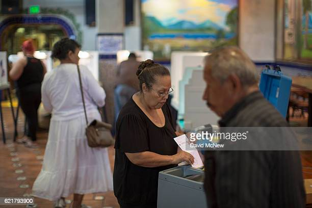 Latinos vote at a polling station in El Gallo Restaurant on November 8 2016 in the Boyle Heights section of Los Angeles California In addition to...