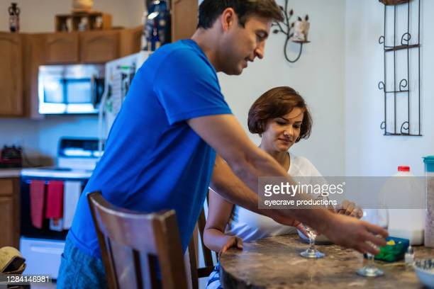 latinx millennial heterosexual couple spending time at home together - eyecrave  stock pictures, royalty-free photos & images