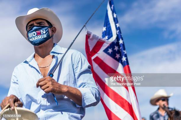 Latinx supporters attend a Biden/Harris Nevada Hispanic Legislative Caucus and supporters on horseback rally at the Walnut Community Center's early...