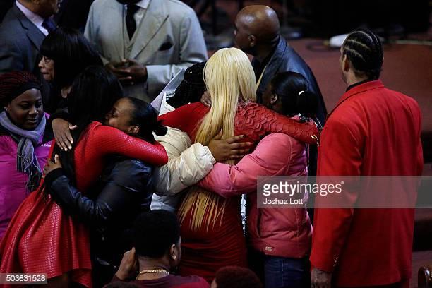 LaTisha Jones and her sister LaTonya Jones receive hugs during the funeral for their mother Bettie Jones at New Mount Pilgrim Missionary Baptist...