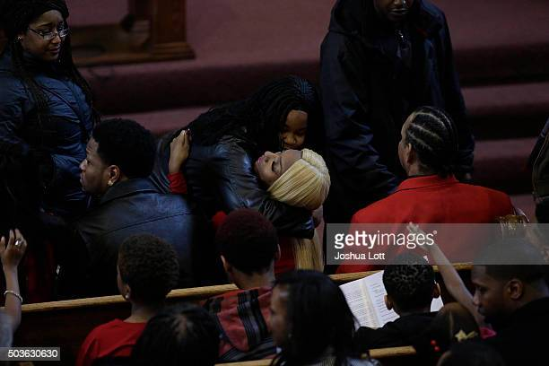 LaTisha Jones receives a hug as she attends the funeral for her mother Bettie Jones at New Mount Pilgrim Missionary Baptist Church January 6 2016 in...