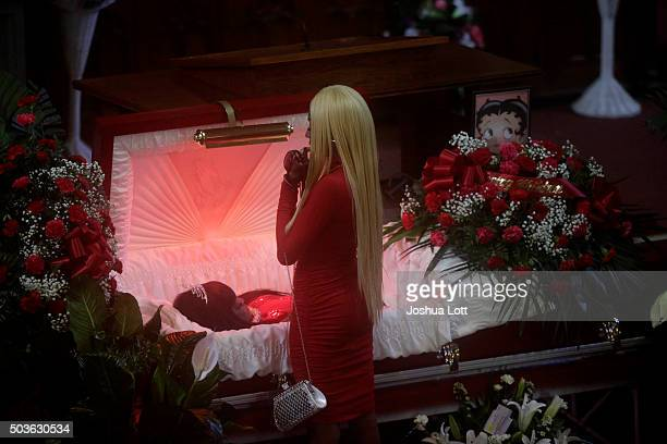 LaTisha Jones stands over her mother Bettie Jones during her funeral at New Mount Pilgrim Missionary Baptist Church January 6 2016 in Chicago...
