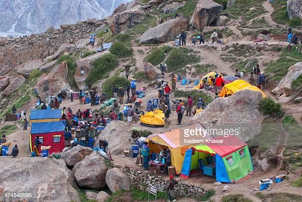 "Latitude: 35°43'39.04"" Longitude: 76°17'6.01"" Urdokas Camp site on the trek to Mighty K2 Mountain of Karakorum range. At early morning porters and..."