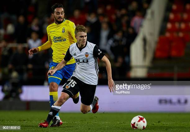 Lato of Valencia CF competes for the ball with Borja of UD Las Palmas during the Copa del Rey Round of 16 second leg game between Valencia CF and Las...