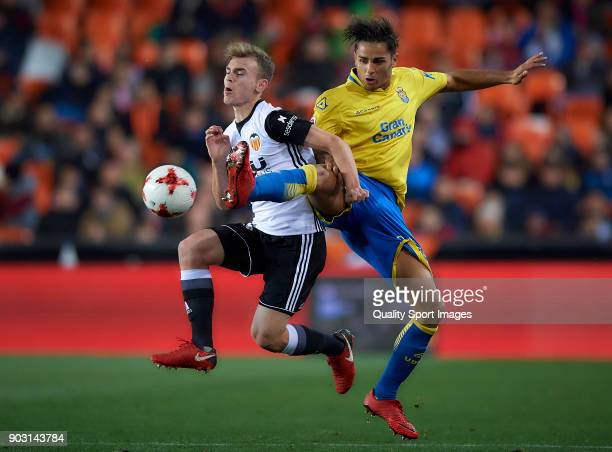 Lato of Valencia competes for the ball with David Simon of Las Palmas during the Copa Del Rey 2nd leg match between Valencia and Las Palmas at...