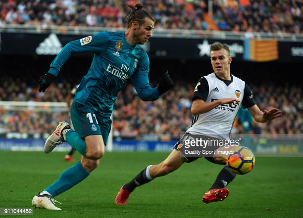 Lato of Valencia competes for the ball with Gareth Bale of Real Madrid during the La Liga match between Valencia and Real Madrid at Estadio Mestalla...