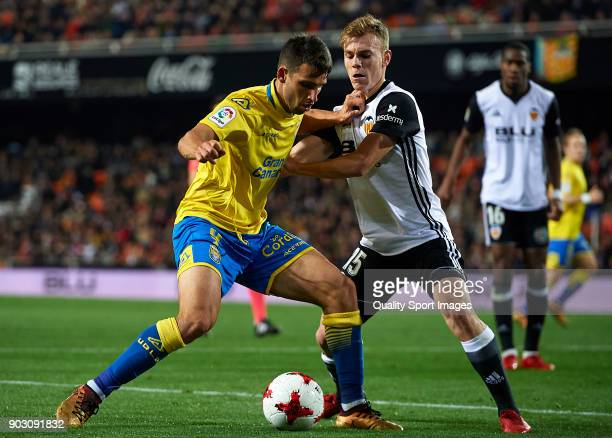 Lato of Valencia competes for the ball with Jonathan Calleri of Las Palmas during the Copa del Rey Round of 16 second Leg match between Valencia CF...