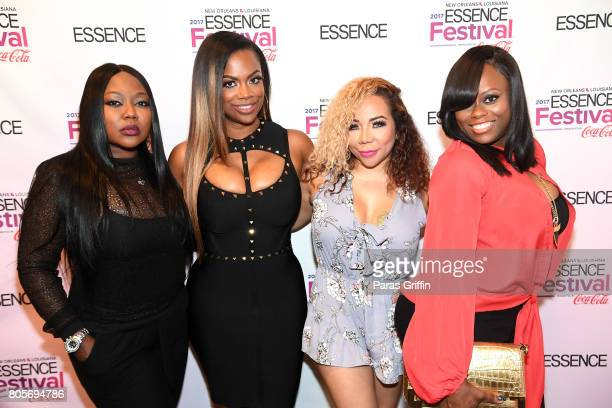 LaTocha Scott Kandi Burruss Tameka 'Tiny' Harris and Tamika Scott of 'Xscape' pose backstage at the 2017 ESSENCE Festival presented by CocaCola at...