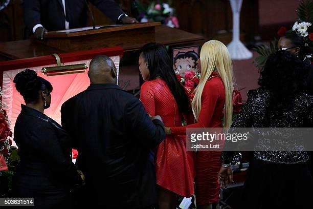 LaTonya Jones and LaTisha Jones stand over their mother Bettie Jones during her funeral at New Mount Pilgrim Missionary Baptist Church January 6 2016...