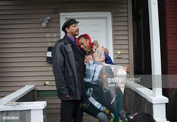 LaTonya Jones the daughter of Bettie Jones gets comfort from her father Garry Mullen during a vigil to honor Bettie a 55yearold mother of 5 on...