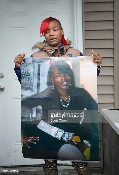 LaTonya Jones the daughter of Bettie Jones holds a picture of her mother during a vigil outside their home on December 27 2015 in Chicago Illinois...