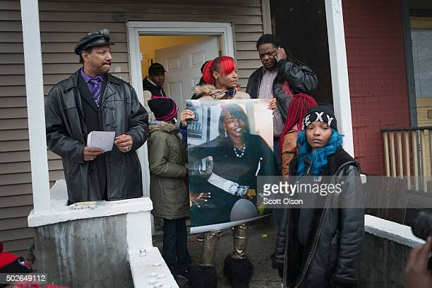 LaTonya Jones the daughter of Bettie Jones holds a picture of her mother during a vigil outside her home on December 27 2015 in Chicago Illinois...