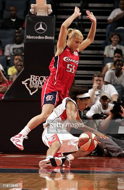 LaToya Bond of the Charlotte Sting is fouled by Anastasia Kostaki of the Houston Comets on August 8 2006 at the Charlotte Bobcats Arena in Charlotte...