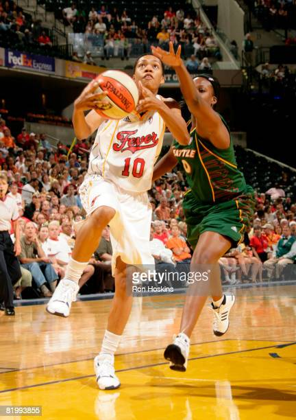 LaToya Bond of the Indiana Fever lays the ball up on Camille Little at Conseco Fieldhouse on July 18 2008 in Indianapolis Indiana NOTE TO USER User...