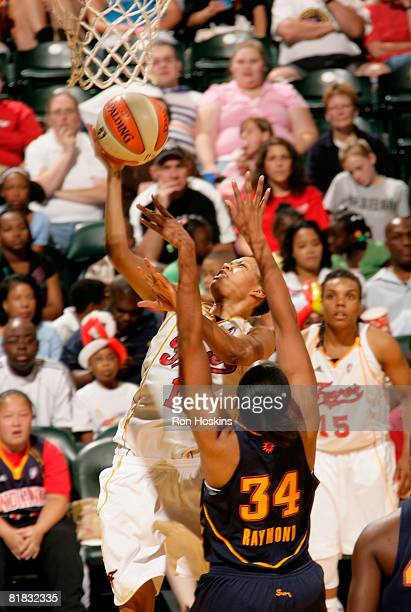 LaToya Bond of the Indiana Fever shoots over Tamika Raymond of the Connecticut Sun at Conseco Fieldhouse on July 5 2008 in Indianapolis Indiana The...