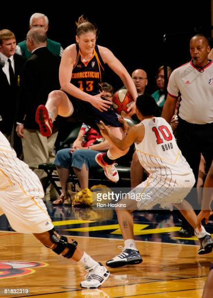 LaToya Bond of the Indiana Fever ties up Lindsay Whalen of the Connecticut Sun at Conseco Fieldhouse on July 5 2008 in Indianapolis Indiana The Fever...