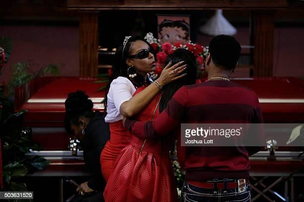 Latoya Jones embraces her sister LaTonya Jones during the funeral for their mother Bettie Jones at New Mount Pilgrim Missionary Baptist Church...