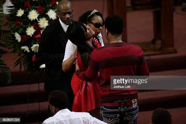 Latoya Jones holds up her sister LaTonya Jones during the funeral for their mother Bettie Jones at New Mount Pilgrim Missionary Baptist Church...