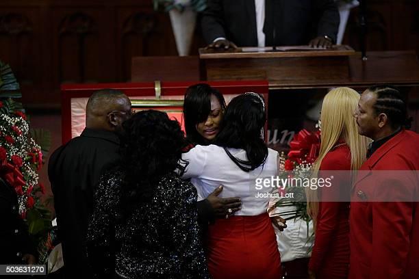 Latoya Jones hugs her sister LaTonya Jones during the funeral for their mother Bettie Jones at New Mount Pilgrim Missionary Baptist Church January 6...