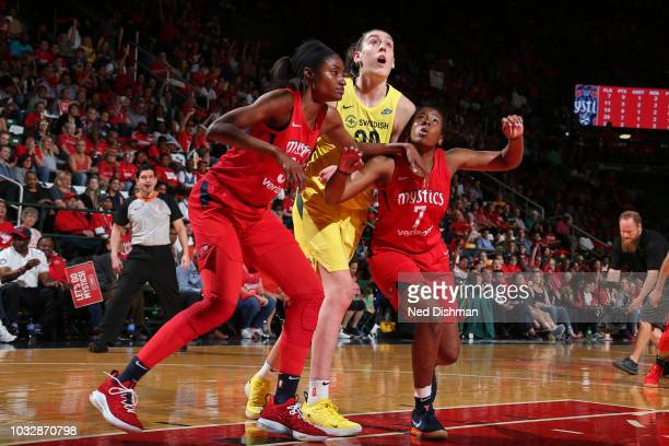 LaToya Sanders and Ariel Atkins of the Washington Mystics box out Breanna Stewart of the Seattle Storm in Game Three of the 2018 WNBA Finals on...