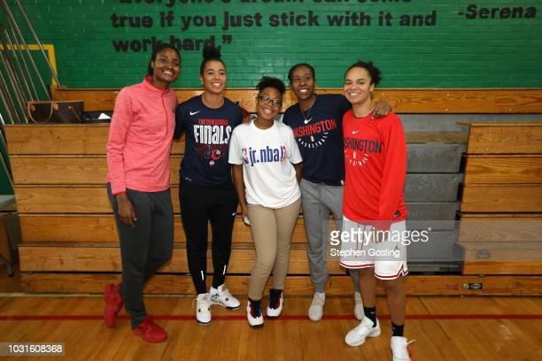 LaToya Sanders Natasha Cloud Ariel Atkins and Kristi Toliver of the Washington Mystics pose with a fan at the 2018 Jr WNBA Clinic on September 11...