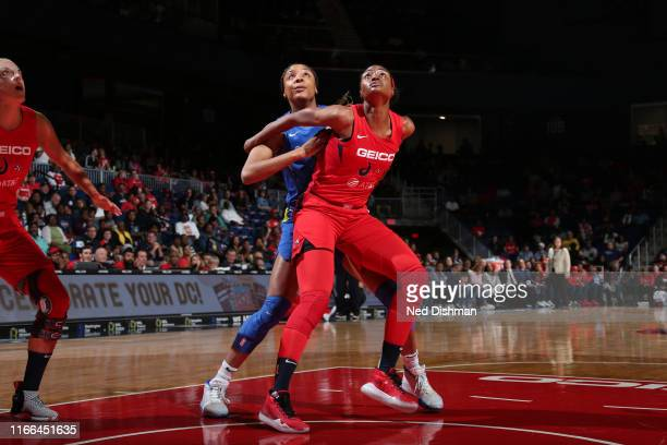 LaToya Sanders of the Washington Mystics and Tayler Hill of the Dallas Wings fights for position to grab the rebound on September 6 2019 at the St...