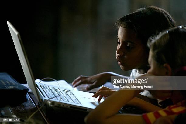 Latoya Sands 8 left from Walgett doing computer skills with La Toya Pinner 12 from Gunnedah at Echidna Gully near Armidale on Tuesday 26 October 2004...
