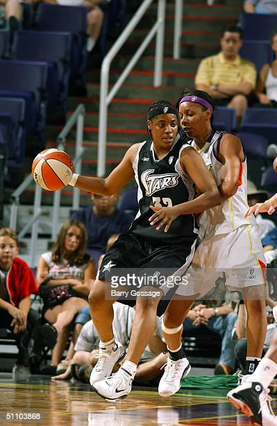 LaToya Thomas of the San Antonio Sliver dribbles against the Phoenix Mercury on July 21 2004 at America West Arena in Phoenix Arizona NOTE TO USER...