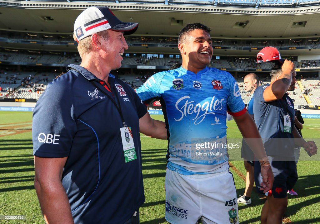 Latrell Mitchell and coach Trent Robinson (L) of the Roosters celebrate winning the 2017 Auckland Nines final between The Sydney Roosters and Penrith Panthers at Eden Park on February 5, 2017 in Auckland, New Zealand.