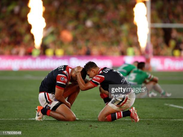 Latrell Mitchell and Daniel Tupou of the Roosters celebrate victory during the 2019 NRL Grand Final match between the Canberra Raiders and the Sydney...