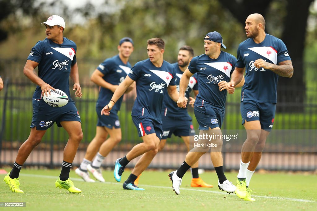 Latrell Mitchell, Cooper Cronk and Blake Ferguson run drills during a Sydney Roosters NRL training session at Kippax Lake on March 5, 2018 in Sydney, Australia.
