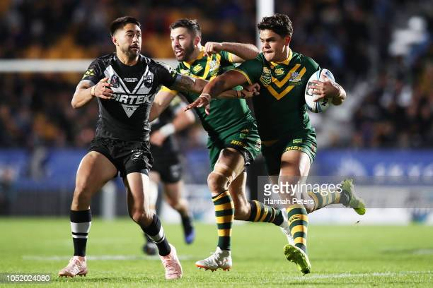 Latrell Mitchell of Australia fends off Shaun Johnson of the Kiwis during the international Rugby League Test Match between the New Zealand Kiwis and...
