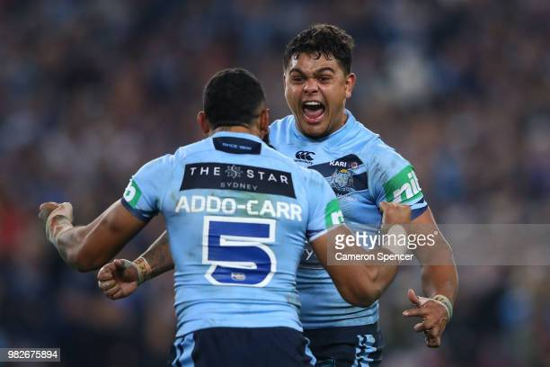Latrell Mitchell of the Blues and Joshua AddoCarr of the Blues celebrate winning game two of the State of Origin series between the New South Wales...