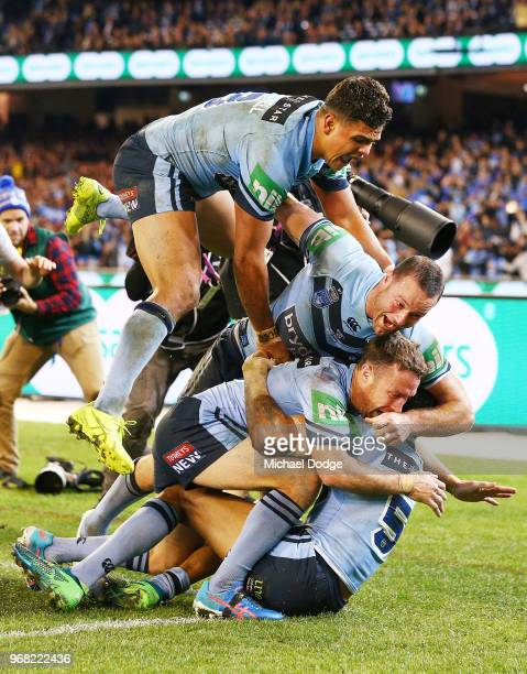 Latrell Mitchell of the Blues and teammates celebrate after Josh AddoCarr of the Blues scores a try during game one of the State Of Origin series...