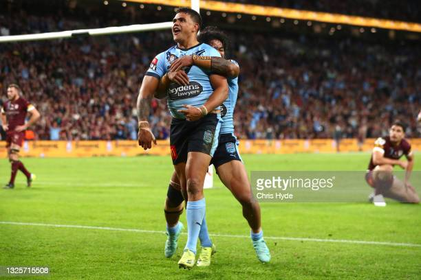 Latrell Mitchell of the Blues celebrates after scoring a try during game two of the 2021 State of Origin series between the Queensland Maroons and...