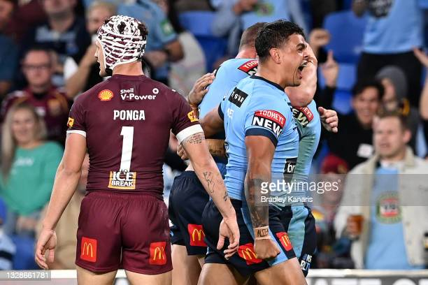 Latrell Mitchell of the Blues celebrates the try scored by Jack Wighton of the Blues during game three of the 2021 State of Origin Series between the...