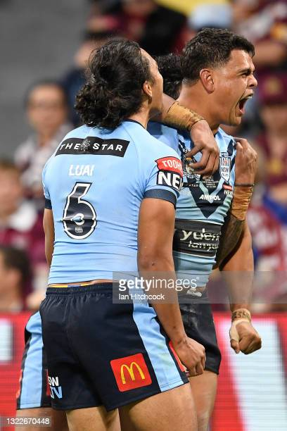 Latrell Mitchell of the Blues celebrates with team mates after scoring a try during game one of the 2021 State of Origin series between the New South...