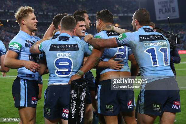 Latrell Mitchell of the Blues celebrates with team mates after scoring a try during game two of the State of Origin series between the New South...