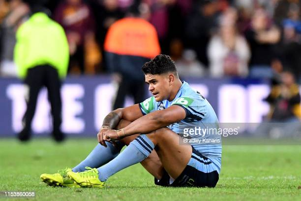 Latrell Mitchell of the Blues is dejected after his team loses game one of the 2019 State of Origin series between the Queensland Maroons and the New...
