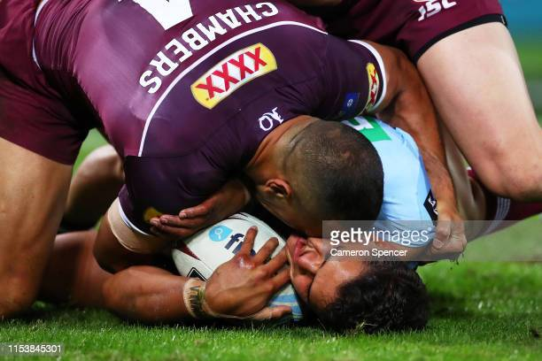 Latrell Mitchell of the Blues is tackled by Will Chambers of the Maroons during game one of the 2019 State of Origin series between the Queensland...