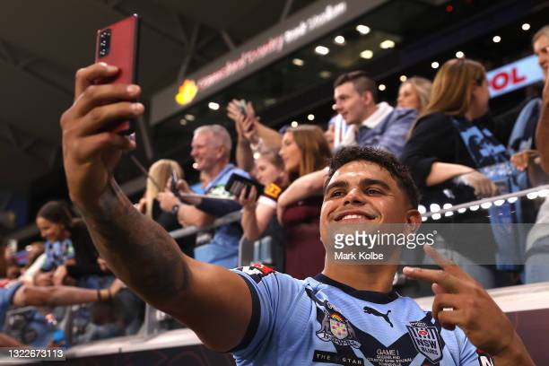 Latrell Mitchell of the Blues poses with fans after winning game one of the 2021 State of Origin series between the New South Wales Blues and the...