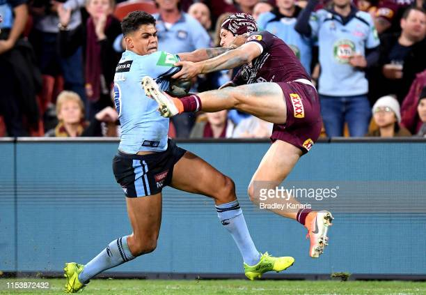 Latrell Mitchell of the Blues pushes away Kalyn Ponga of the Maroons during game one of the 2019 State of Origin series between the Queensland...