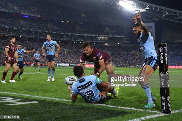 Latrell Mitchell of the Blues scores a try during game two of the State of Origin series between the New South Wales Blues and the Queensland Maroons...