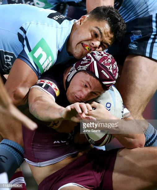 Latrell Mitchell of the Blues tackles Kalyn Ponga of QLD during game one of the 2019 State of Origin series between the Queensland Maroons and the...